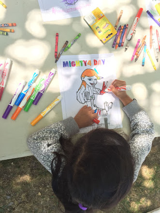 """Getting creative at the Art Station with coloring sheets and artwork by artist Ken """"East3"""" Nishimura of Keep it Flowing Media."""