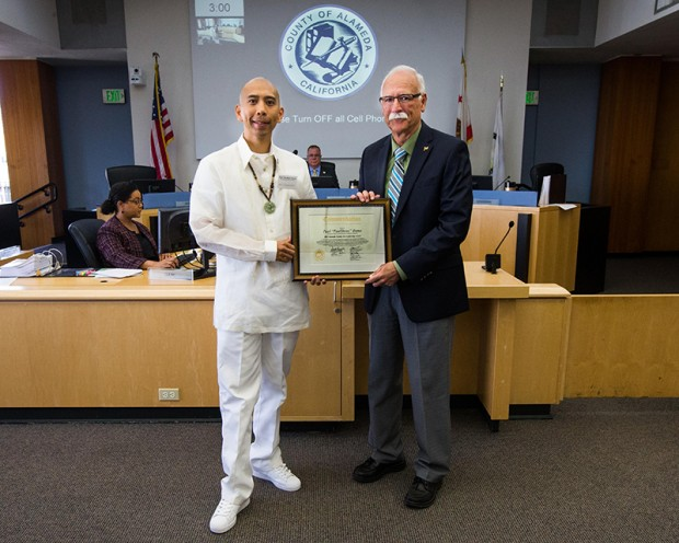Mighty4 Arts Foundation Founder & President, Paulskeee, receiving the Alameda County Arts & Leadership Award from District 2 Supervisor, Richard Valle.