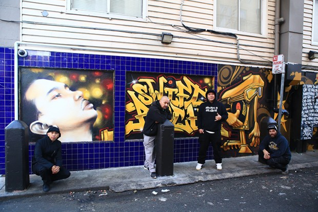 Figure 1: Mighty4 Founder & Aerosol Artists at the #SwiftRockForever mural. Left to Right: Paulskeee, Vogue, East3, Kraze1Da. Photo by #Rawkbeez